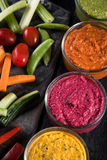 Fresh vegetables and vibrant dip selection Stock Photos