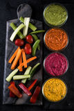 Fresh vegetables and vibrant dip selection Stock Image