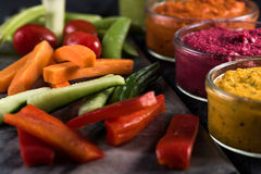 Fresh vegetables and vibrant dip selection Stock Images