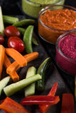 Fresh vegetables and vibrant dip selection Stock Photography