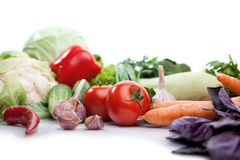 Fresh vegetables on white. A lot of fresh, different vegetables on white stock photo