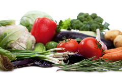 Fresh vegetables on white. A lot of fresh, different vegetables on white stock image