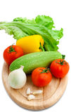 Fresh vegetables on white background. Assorted fresh vegetables on cutting board Royalty Free Stock Photo