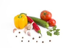 Fresh vegetables on a white background. Yellow pepper, green cucumber, red tomato and bitter pepper on a white background. Stock Photos