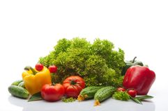 Fresh vegetables on a white background. Tomatoes, cherry tomatoes, cucumbers, salad, yellow red and green pepper on white background Stock Photography