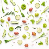 Fresh vegetables on a white background. Vegetable food background. Pattern of potatoes, radish, lettuce, green pepper, young garlic, sorrel. Top view royalty free stock photos