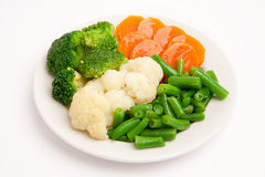 Fresh vegetables on white plate royalty free stock photos