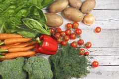 Fresh vegetables on a white wooden background Royalty Free Stock Photos