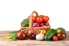 Fresh vegetables in wicker basket. On table Royalty Free Stock Photos