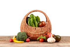 Fresh vegetables in wicker basket. On table Stock Photography