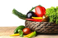 Fresh vegetables in wicker basket. On table Stock Photo