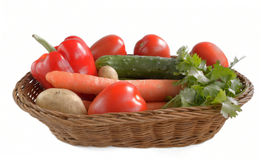 Fresh vegetables are in a wicker basket  on white backgr Stock Images