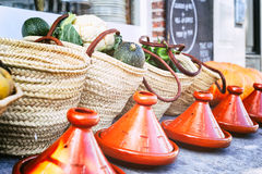 Fresh vegetables in wicker baskets with tagines stock image