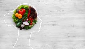 Fresh vegetables in woman head symbolizing health nutrition