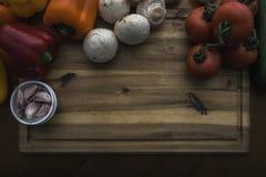 Food on board. Fresh Vegetables on wood cutting board Stock Photos