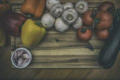 Food on board. Fresh Vegetables on wood cutting board Stock Photo
