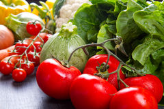 Fresh vegetables on wood. Some fresh vegetables on wood royalty free stock image