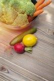 Fresh vegetables on wood table. Closeup photograph of fresh vegetables on wood table Royalty Free Stock Photos