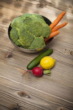 Fresh vegetables on wood table Stock Images