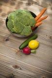 Fresh vegetables on wood table. Closeup photograph of fresh vegetables on wood table Stock Images