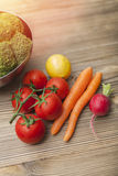 Fresh vegetables on wood table. Closeup photograph of fresh vegetables on wood table Stock Photography