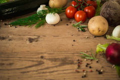 Fresh vegetables on a wooden background. Stock Photos