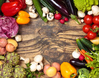 Fresh vegetables on wooden background. Collection of mixed organic vegetables and herbs on old wooden background Royalty Free Stock Photos