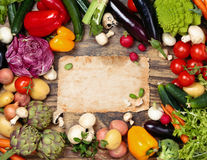 Fresh vegetables on wooden background. Collection of mixed organic vegetables and herbs on old wooden background Royalty Free Stock Photo