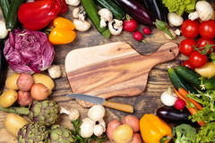 Fresh vegetables on wooden background. Collection of mixed organic vegetables and herbs on old wooden background Royalty Free Stock Images