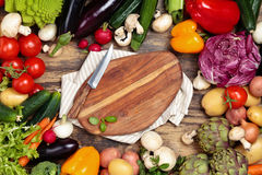 Fresh vegetables on wooden background. Collection of mixed organic vegetables and herbs on old wooden background Stock Photo