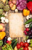 Fresh vegetables on wooden background. Frame of mixed organic vegetables and herbs on old wooden background Stock Photography