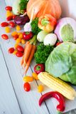 Fresh vegetables on a wooden background. Healthy food Stock Images