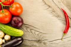 Fresh vegetables on wooden background. The icon for healthy eating, diets, weight loss. Ripe fresh vegetables on wooden background. The icon for healthy eating royalty free stock photos