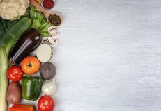 Fresh vegetables on wooden background. Top view Stock Photos