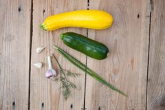 Fresh vegetables on wooden background, top view Stock Photos