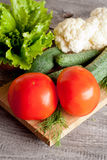 Fresh vegetables on a wooden background. Vertical Royalty Free Stock Photo