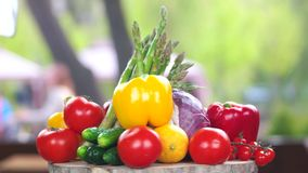 Fresh vegetables on wooden board. Bell peppers, tomatoes and asparagus stock video