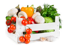 Fresh vegetables in wooden box Stock Photos