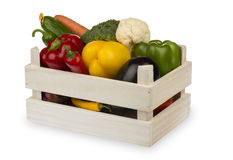 Fresh vegetables in the wooden box isolated on the white background. Royalty Free Stock Images
