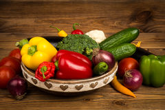 Fresh vegetables in the wooden box on the rustic background. Fresh vegetables in the box on the rustic background Royalty Free Stock Photos