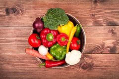 Fresh vegetables in the wooden box on the rustic background. Fresh vegetables in the box on the rustic background Royalty Free Stock Image