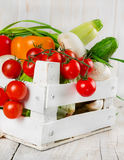 Fresh vegetables in a wooden box. Fresh vegetables in a white painted wooden box Stock Images
