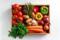 Fresh Vegetables in wooden box on white wooden background.  Stock Images