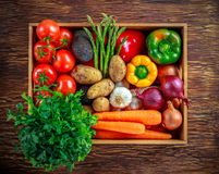 Fresh Vegetables in wooden box on wooden background.  Stock Photography