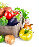 Fresh vegetables in wooden bucket with greens Royalty Free Stock Photography