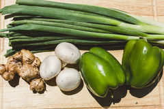 Fresh vegetables on wooden chopping board Royalty Free Stock Photo