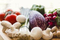 Fresh vegetables on wooden chopping board Stock Photos