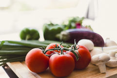 Fresh vegetables on wooden chopping board Stock Photo