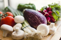 Fresh vegetables on wooden chopping board Stock Images