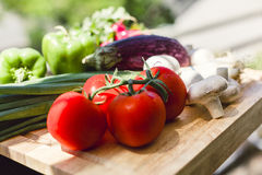 Fresh vegetables on wooden chopping board Royalty Free Stock Image